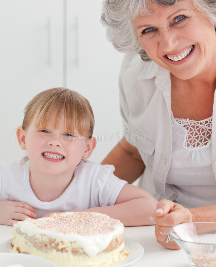 Download Lovely Girl And Her Grandmother In A Kitchen Stock Image - Image of family, adorable: 18108769