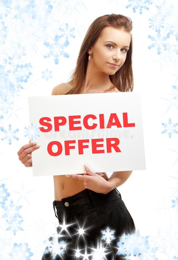 Lovely girl holding special offer board royalty free stock photos
