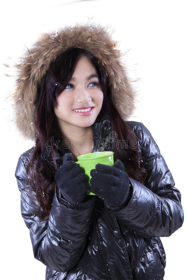 16e94d171 Lovely girl holds hot drink. Lovely girl wearing winter jacket and holding  a cup of