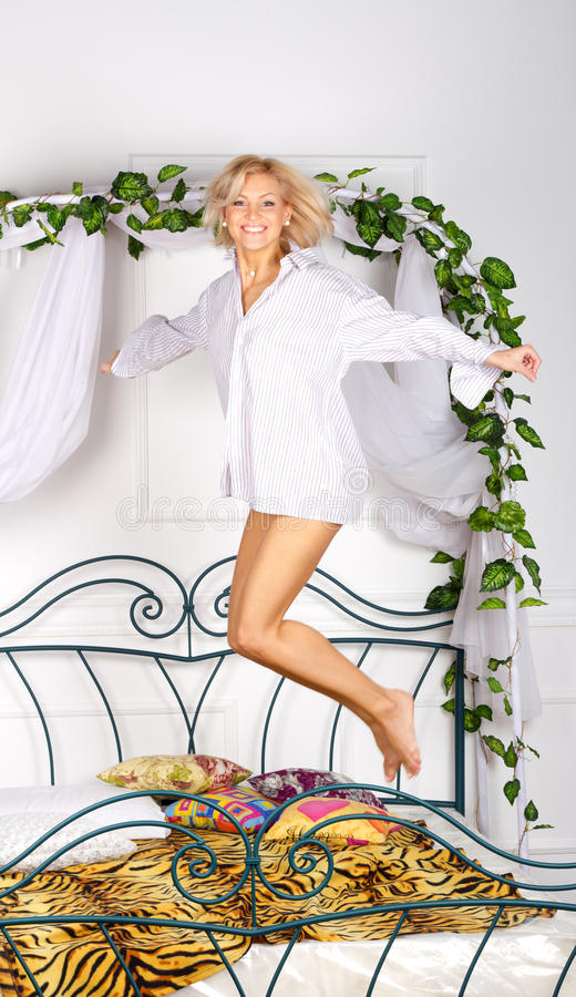 Free Lovely Girl Jumping On The Bed Royalty Free Stock Photography - 22132527