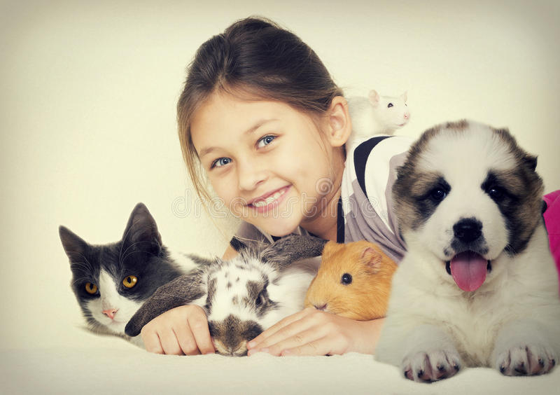 Lovely girl and pets. Lovely girl and a group of pets