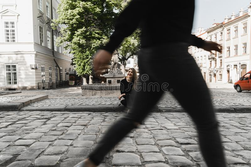 Lovely girl posing in in the old street. Concept of youth and beauty royalty free stock photos