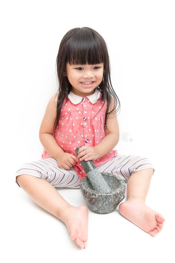 The girl is pounding stone. royalty free stock images