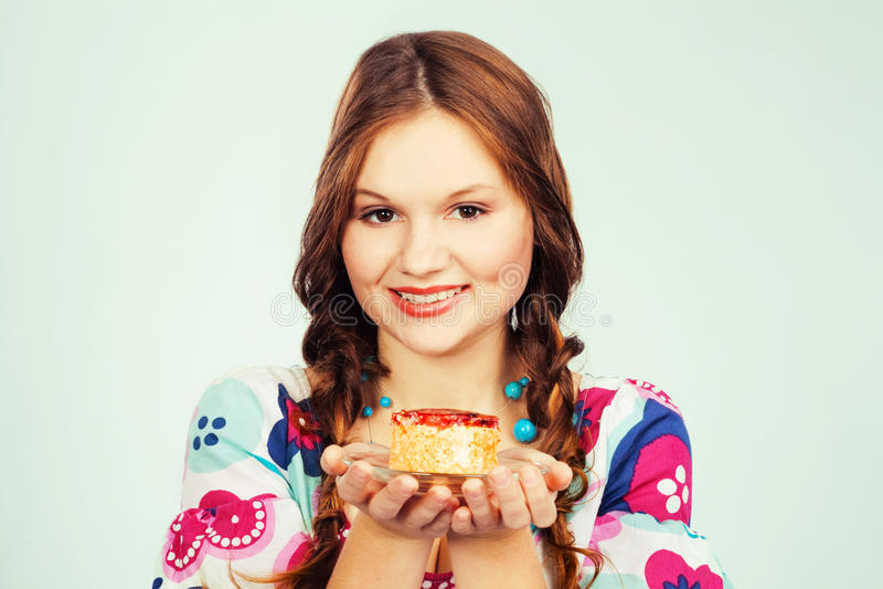 Lovely girl proposing cake. Lovely girl proposing fruit cake stock images