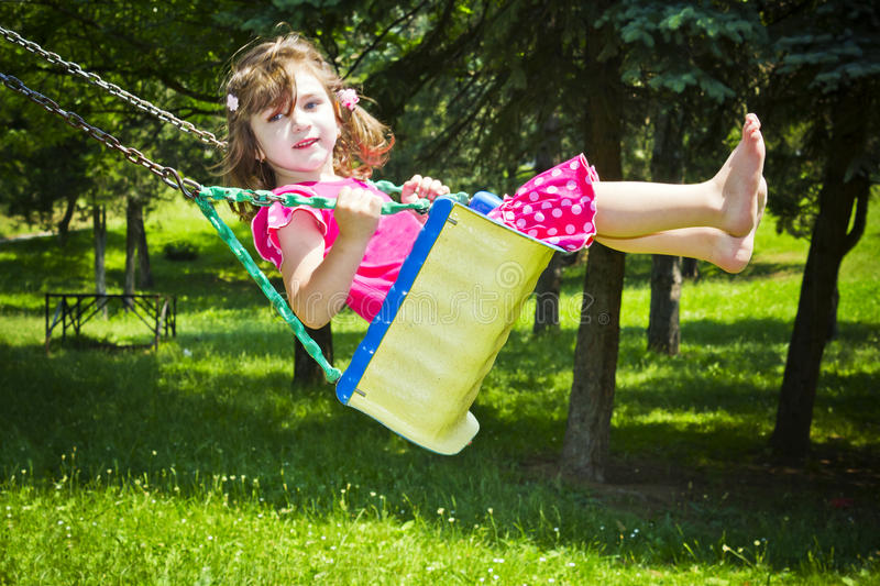 Download The Lovely Girl Shakes On A Swing Stock Image - Image: 22409365