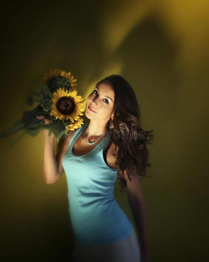 Lovely girl and sunflowers royalty free stock images