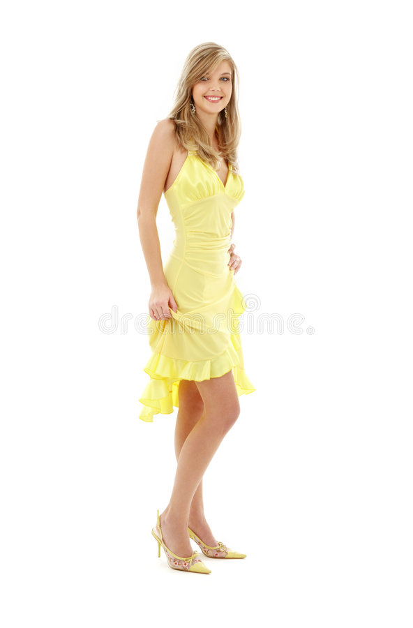 Lovely girl in yellow dress stock photo