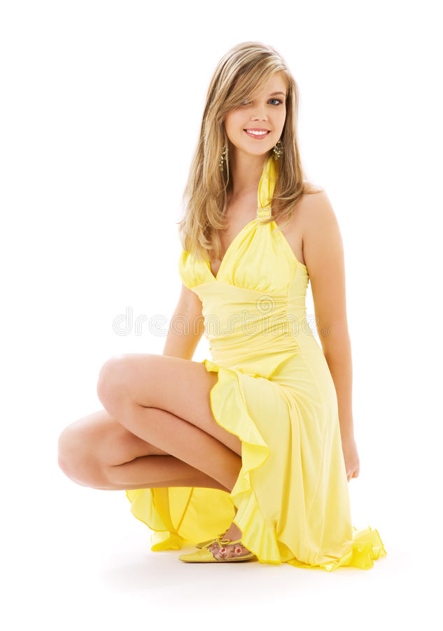 Lovely girl in yellow dress royalty free stock photo