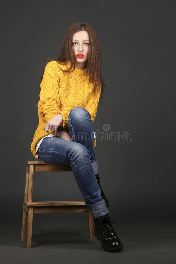 Lovely girl in a yellow with gorgeous hair, red lips stock image
