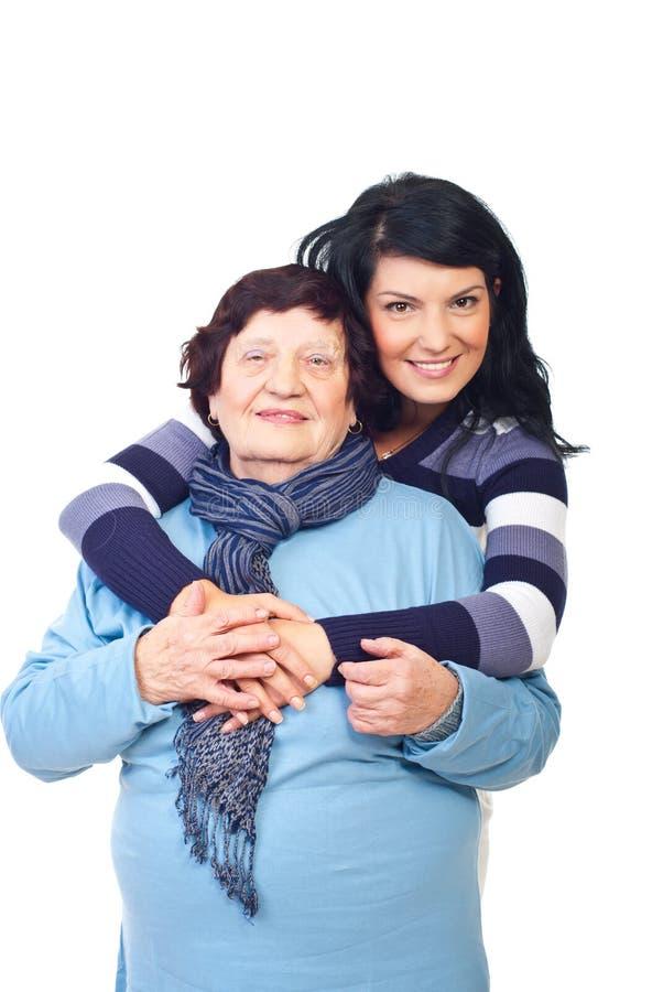Lovely granddaughter and grandma hug stock photography