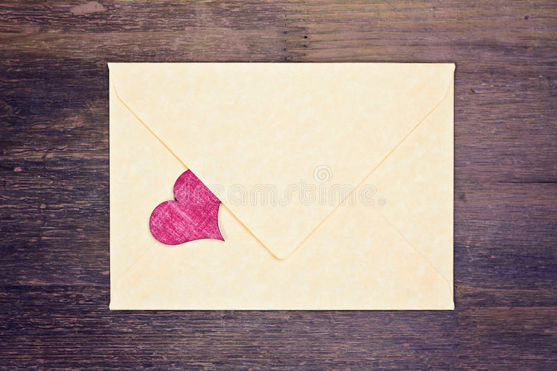 Lovely greeting card - mailer with red heart stock photo