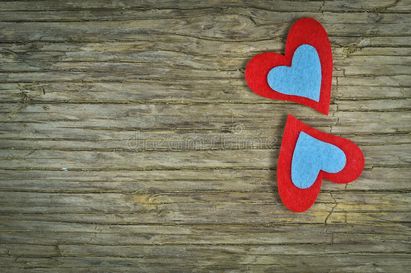 Lovely hearts. Lovely colorful hearts on a wooden background royalty free stock photo