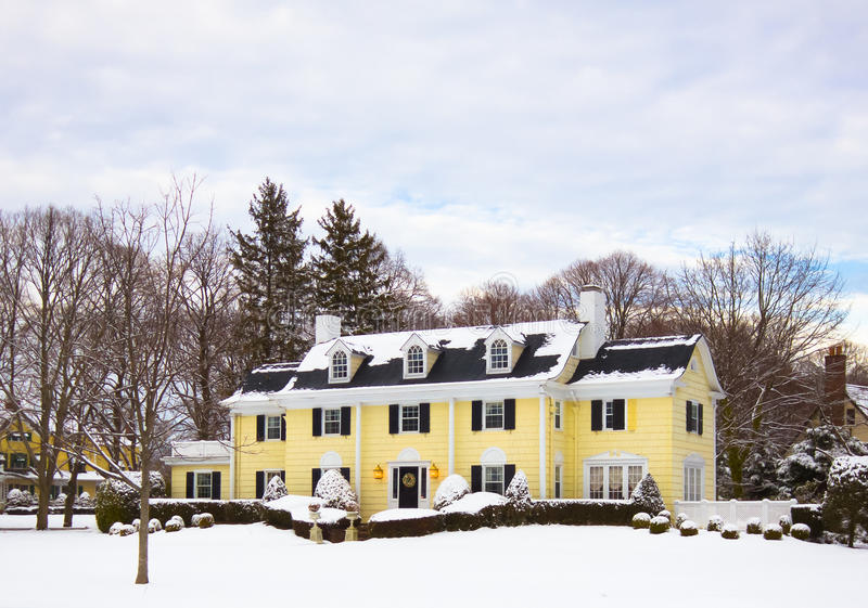 Lovely Home in Snow. A typical American home on a snowy day royalty free stock photography