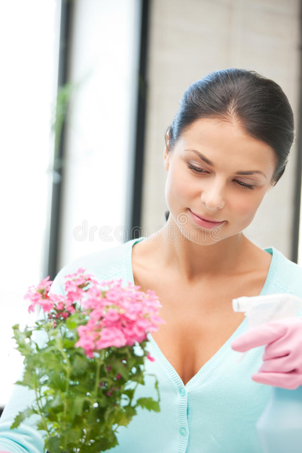Lovely housewife with flower royalty free stock photos