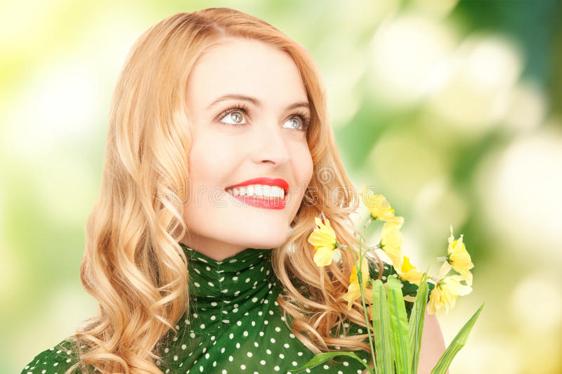Lovely housewife with flower royalty free stock image