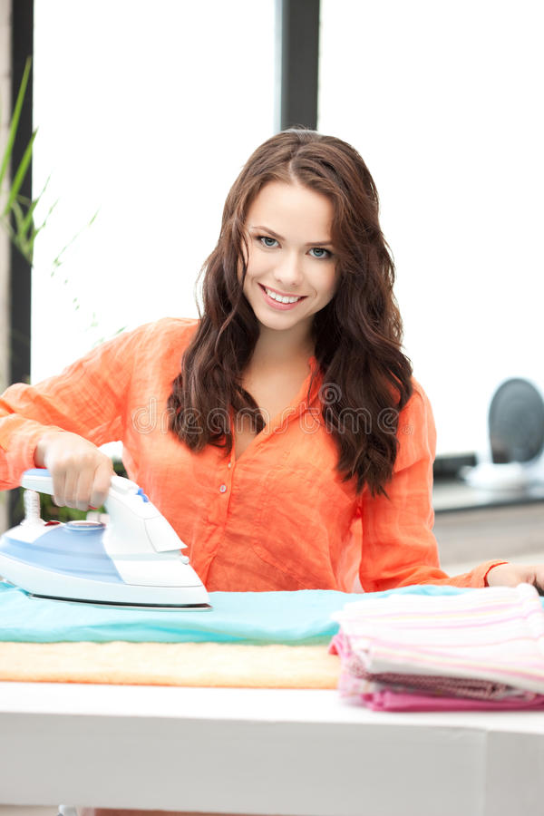 Lovely housewife with iron royalty free stock photography