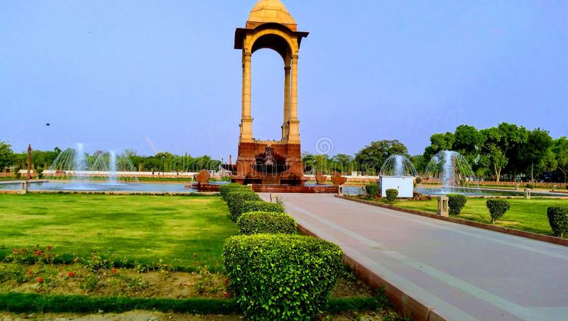 Lovely India Gate behind scene. Behind India gate their is lovely garden. This shot is taken from that garden stock photo