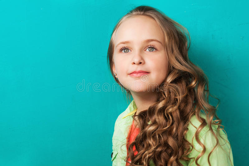 Lovely inspired little lady. Looking up stock photo