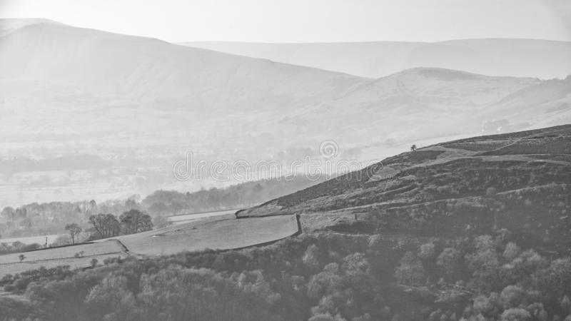 Lovely landscape image of the Peak District in England on a hazy Winter day viewed from the lower slopes of Bamford Edge in black royalty free stock images