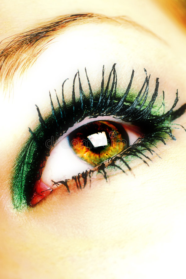 Lovely lashes. Beautiful eye with makeup, cross processed royalty free stock photography