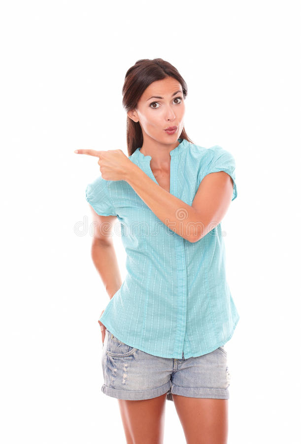 Lovely latin woman pointing to her right royalty free stock image