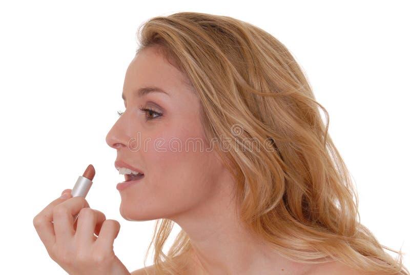 Lovely Lipstick 2. Lovely girl applying lipstick stock image