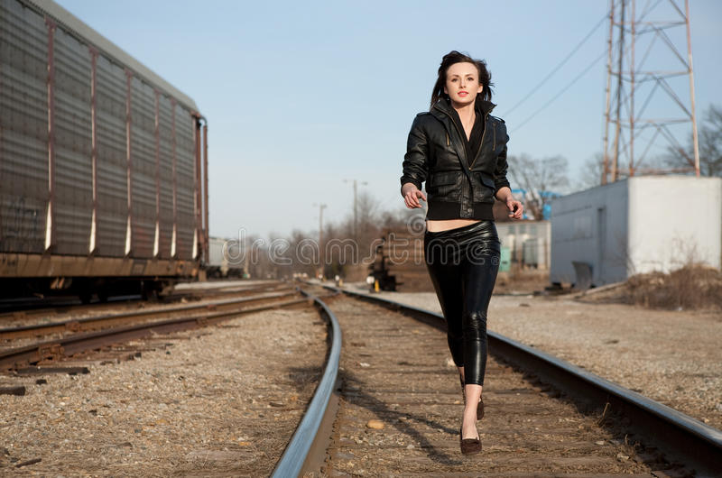 Lovely Lithe Model Running Along Train Tracks royalty free stock photos