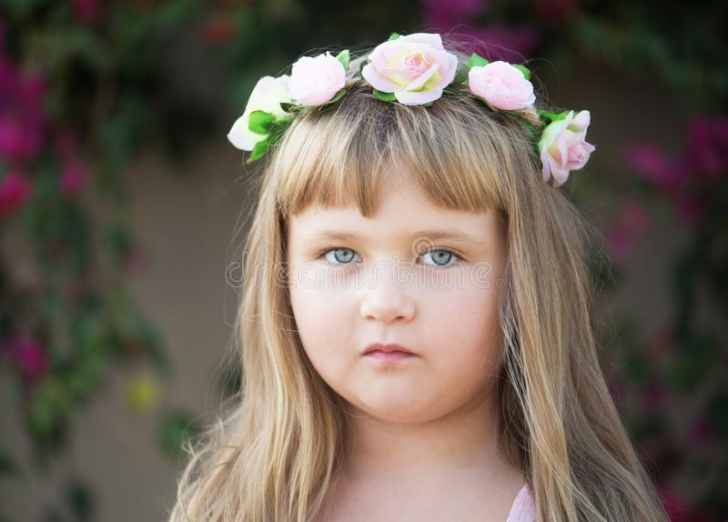 Lovely little baby girl with daisy wreath on her head royalty free stock photography