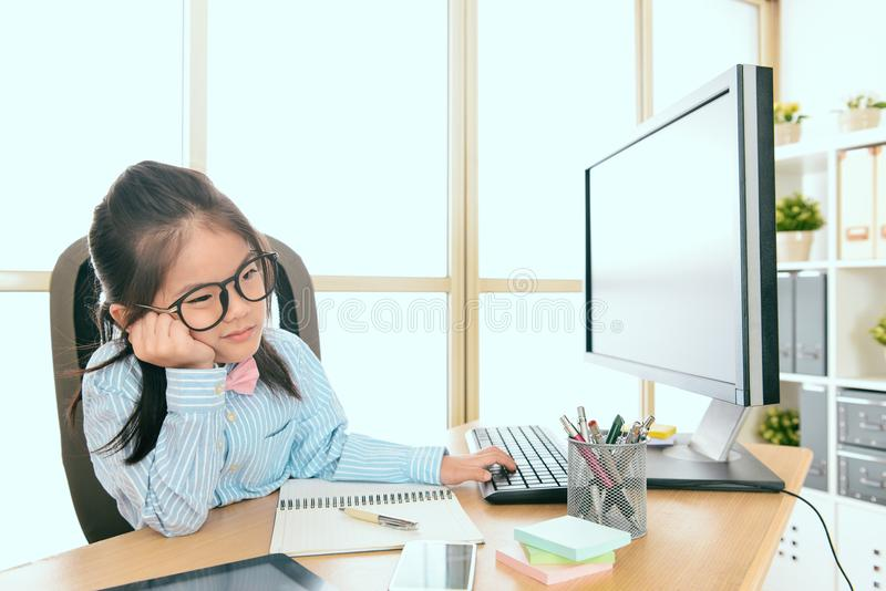 Lovely little girl children dress up as business. Lovely beauty little girl children dress up as business woman sitting in office feeling boring royalty free stock photography