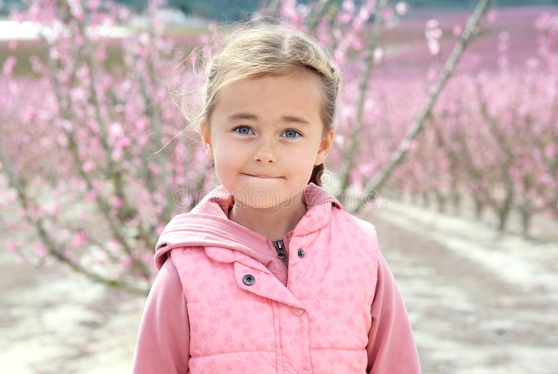 Lovely little girl in a grove of fruit trees in Cieza in the Murcia region. Peach, plum and nectarine trees. Spain royalty free stock image
