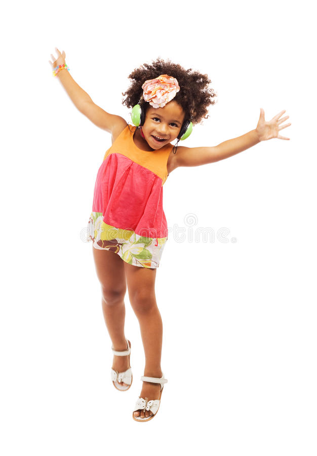 Lovely little girl in headphones having fun royalty free stock photos