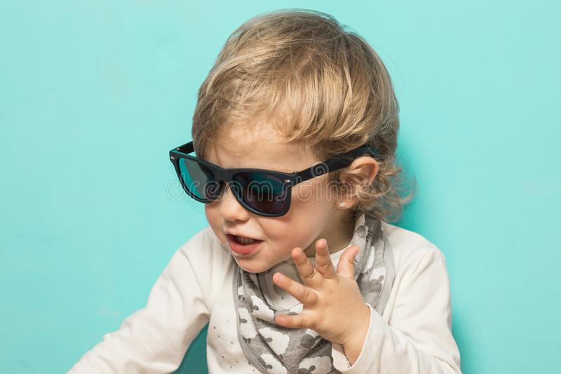 Lovely little girl with sunglasses and funny expression royalty free stock photos