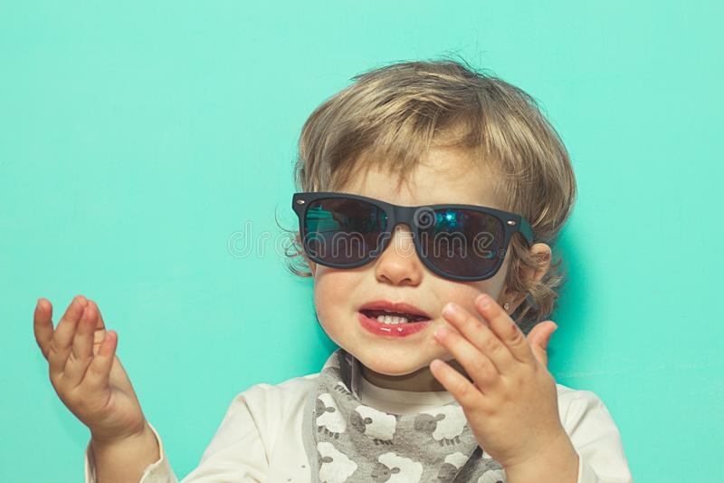 Lovely little girl with sunglasses and funny expression stock photo