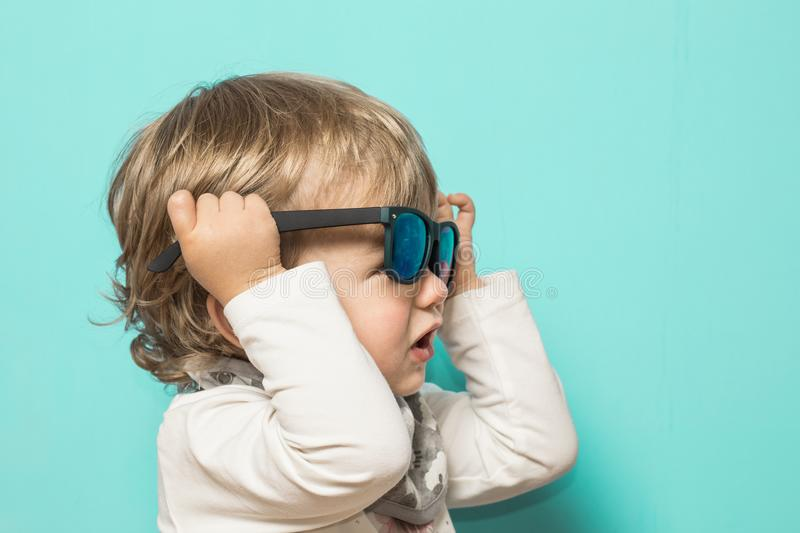 Lovely little girl with sunglasses and funny expression stock photography