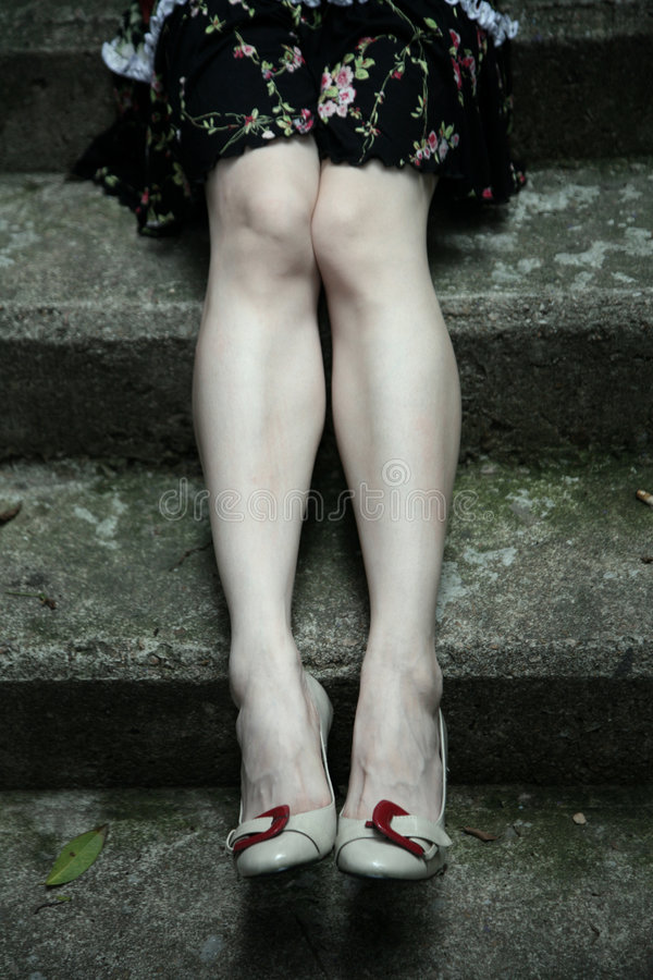 Lovely long legs in heels royalty free stock photo