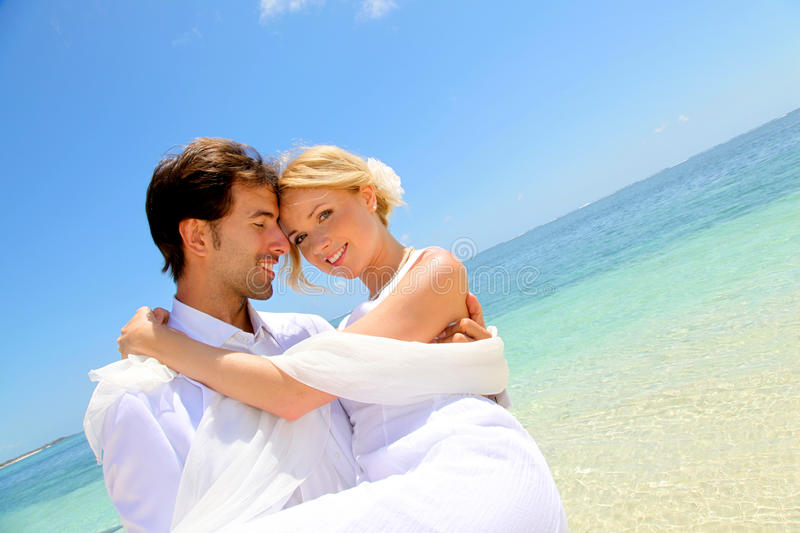 Lovely married couple at the beach royalty free stock photography