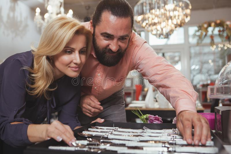 Lovely mature couple buying kitchenware at the store stock image