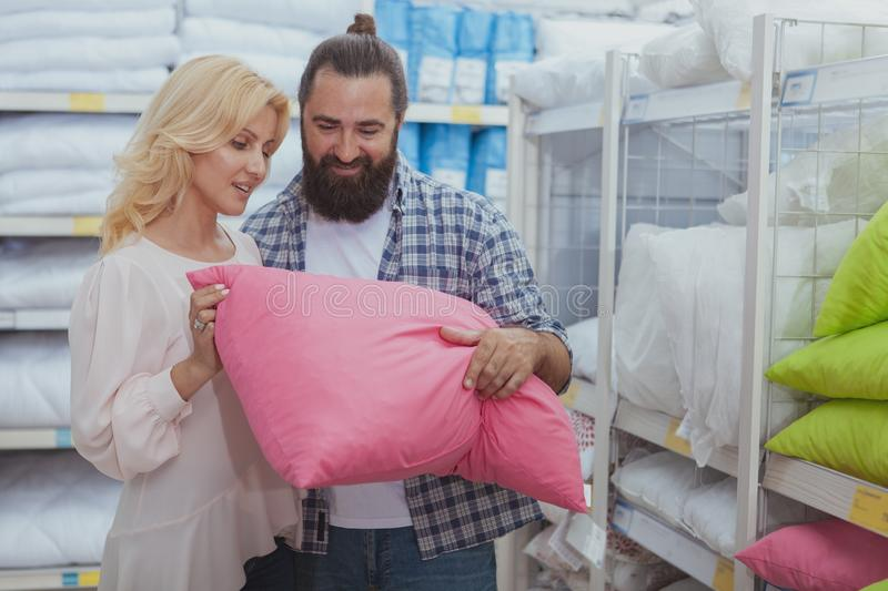 Lovely mature couple buying new pillows royalty free stock photo