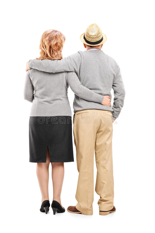Lovely mature couple. Full length portrait of a lovely mature couple isolated on white background, rear view royalty free stock image