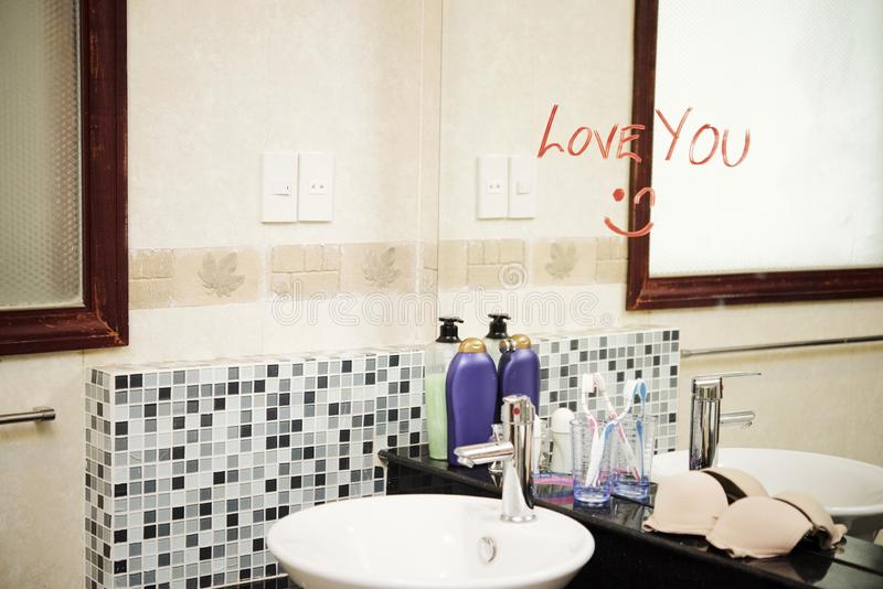 Lovely message in the bathroom stock photography