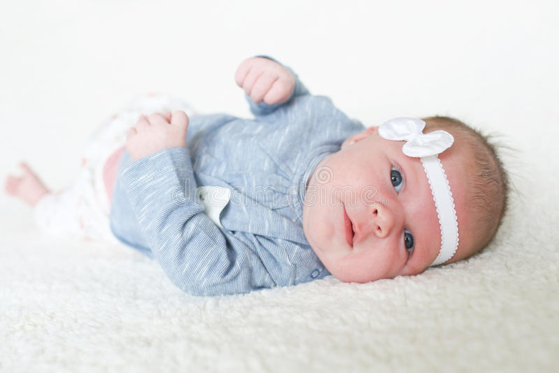 Lovely 1 months baby girl. Portrait of happy blue-eyed baby girl (1 month stock images