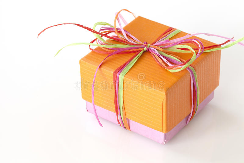 Lovely orange and pink present (gift box). With ribbons royalty free stock photo