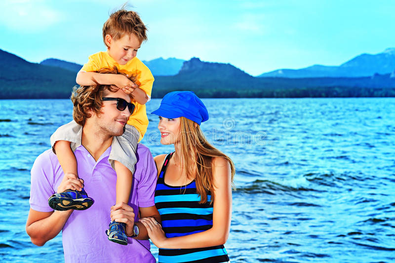 Lovely parents. Portrait of a happy family with little son on vacation stock photos