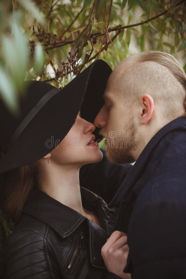 Lovely photo of a kissing couple stock photography