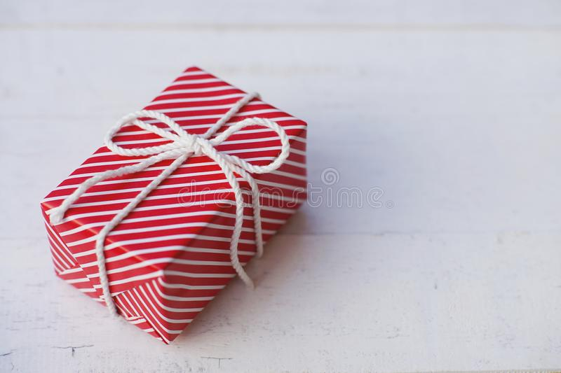 Lovely red color gift box decorated with mini red heart figure, sweet valentine present concept, background and texture for. Valentine day, copy space stock photo