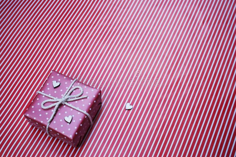 Lovely red color gift box decorated with mini red heart figure, sweet valentine present concept, background and texture for. Valentine day, copy space royalty free stock photos