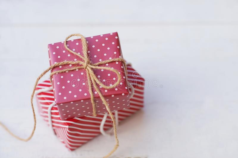 Lovely red color gift box on white background, sweet valentine present concept, background and texture for valentine`s day. Copy space royalty free stock images