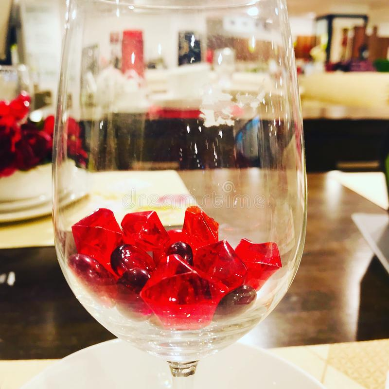 Lovely red stones in glass. Just click the beauty of the red stone glass at Dining royalty free stock image