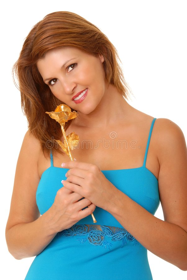 Lovely Redhead Girl with golden rose royalty free stock photo