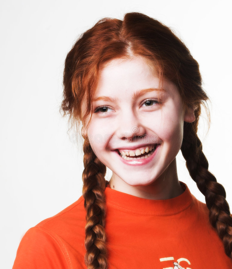 Lovely redhead girl with long braids stock photo
